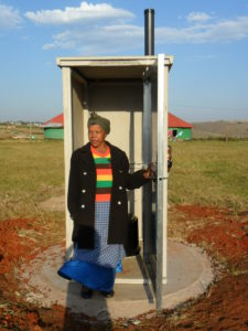 Chief-Nophangele-standing-outside-the-finished-toilet-in-Gatyana