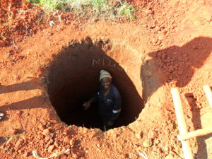 Happy-benefictor-of-VIP-toilet-in-Mhlohlozi-after-digging-his-own-pit
